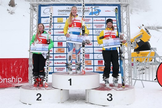 The Ladies' Downhill podium, category U18, of the Swiss Junior Championships Speed 2015 in Crans-Montana. From the left: Noemi Kolly (SC La Berra), Thea Waldleben (Swiss champion/SC Horw) and Natalie Hauswirth (SC Gstaad).